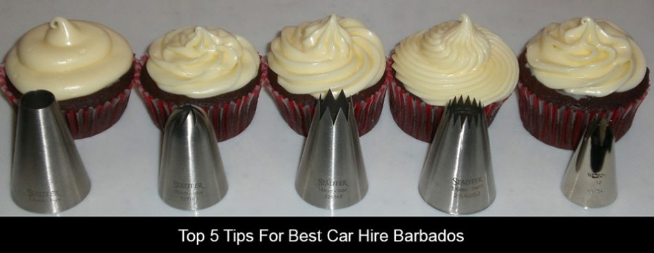 five muffins and five piping tips on a table