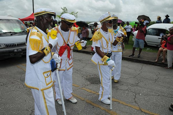 men dressed in traditional uniforms at Crop Over festival in Barbados