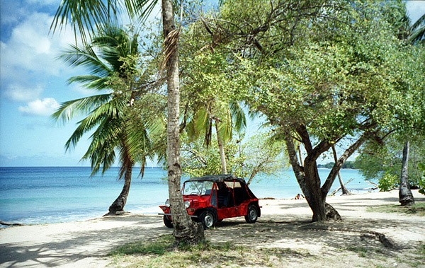 rental car parked next to a beach in Barbados