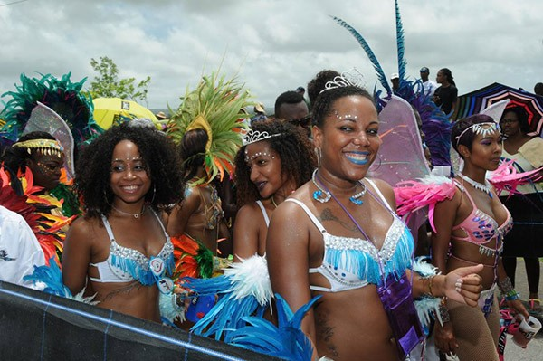 smiling women dressed in carnival costumes